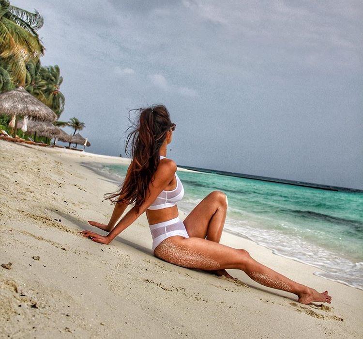 Disha Patani Chilling On The Beach In A white Bikini